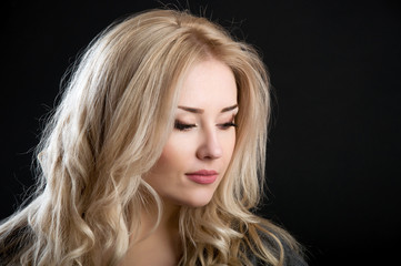 contour of beautiful blonde with curly hair