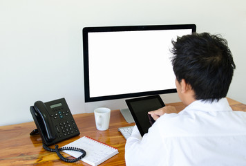 Man use tablet and computer in the office.