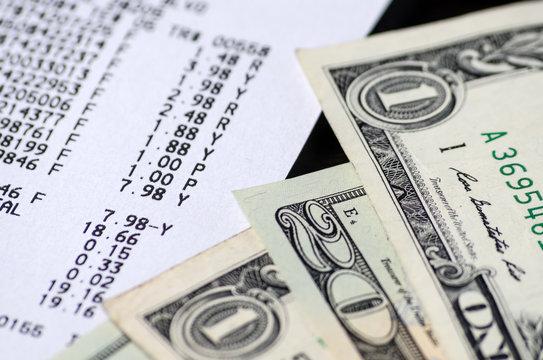American dollars and receipt closeup