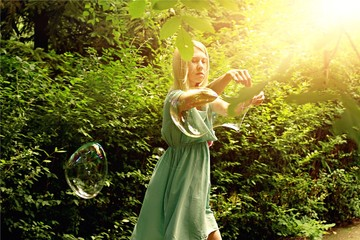 Young women with huge soap bubbles