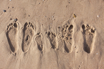 Family footprints on the sand beach in Side, Turkey