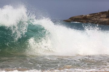 sea wave coast surf foam blue background