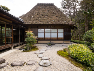 Japanese rock garden with tea house