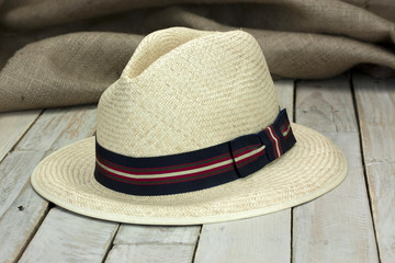 Straw hat on rustic surface