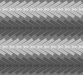 Monochrome pattern with striped white and black chevron on dark