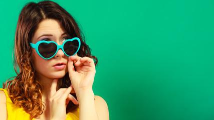 Girl in green sunglasses portrait