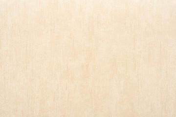 Vertical rough texture of vinyl wallpaper for abstract backgrounds of beige color
