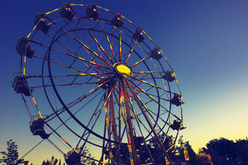 Carnival Ferris Wheel during a beautiful summer sunset