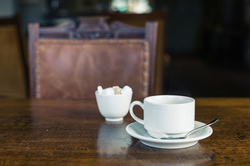 Cup of tea on table in dining room