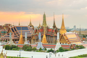 The beauty of the Emerald Buddha Temple at twilight. And while the gold of the temple catching the light. This is an important buddhist temple of thailand and a famous tourist destination.