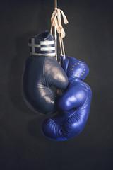 Boxing gloves as a symbol of Greece vs. the EU