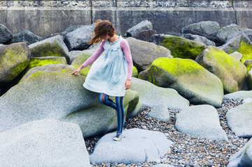 Young woman walking amongst vibrant rocks