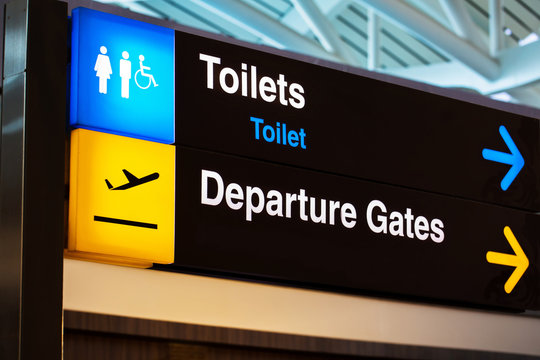 Airport sign for toilet and departure gates