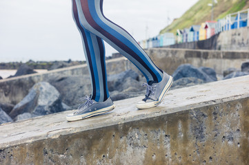 Legs of woman walking on the coast