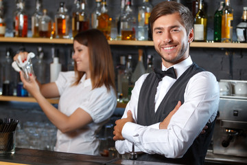 Bartender and a waitress during work