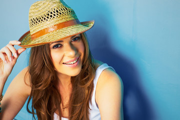 beautifull woman with straw hat smiling and happy