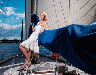 Stylish wealthy woman on a luxury yacht