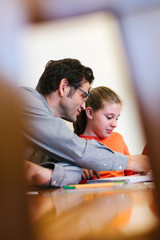 Little Cute Girl Doing Homework with Her Father