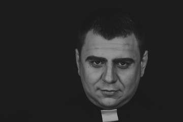 The priest. An actor dressed as a Catholic priest. Theatrical productions. Professional stage Grimm. Art, theater, Grimm. Makeup.
