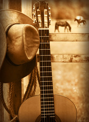 Cowboy hat and guitar.American music background
