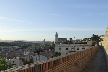The route over medieval walls. Aerial view with Saint Felix Church and the cathedral of Girona, Catalonia