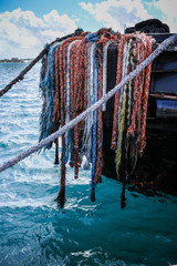 Colorful ropes on boat in Caribbean