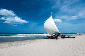 Beautiful canves boat in the beach in hot sunny day
