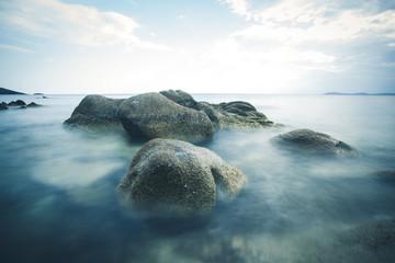 Long exposure of boulder at sea