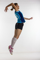 young athletic volleyball player returns the ball