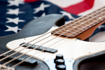 Vintage Bass guitar body on american flag background. selective focus image with shallow depth of field