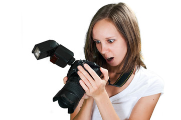 Teenage girl with her digital camera isolated on white background