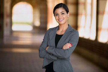 Happy successful smiling business woman executive female in a suit