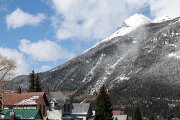 Homes in downtown Silverton, Colorado, surrounded by snow capped mountains