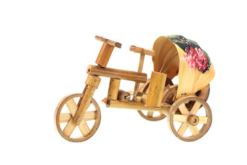 tricycle toy made from bamboo isolated on white background
