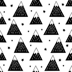 Seamless pattern with geometric snowy mountains and stars. Black and white nature illustration. Cute mountains background.