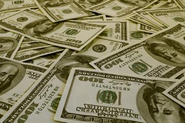 Mount of hundred dollar banknotes background texture filtered
