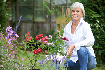 Portrait Of Mature Woman Gardening