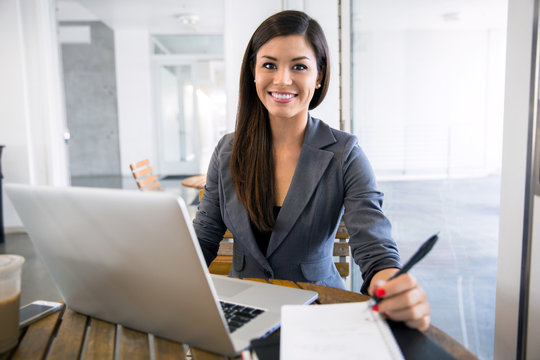 Beautiful young adult business finance executive worker writer at a coffee shop