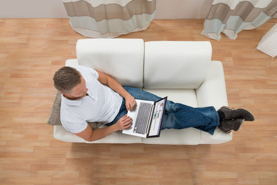 Man With Laptop Chatting On Social Website