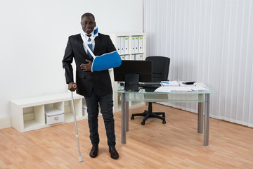 Disabled Businessman Standing In Office