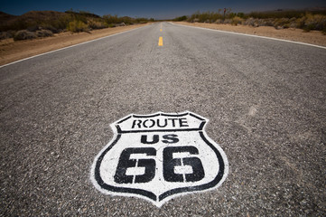 Deurstickers Route 66 Route 66 pavement sign sunrise in California's Mojave desert.