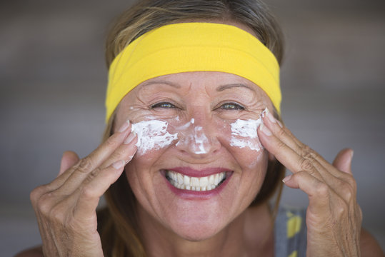Skin care lotion joyful mature woman