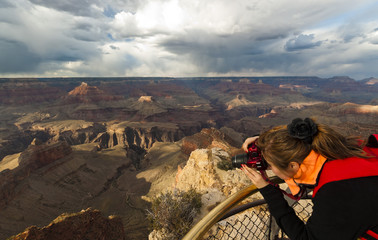 Young woman hiker enjoying nature landscape in Grand Canyon, Arizona, USA.