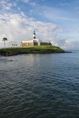 Scenic view of the Farol da Barra lighthouse in soft morning light in Salvador, Bahia, Brazil