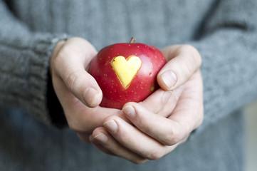 An apple in man's hands
