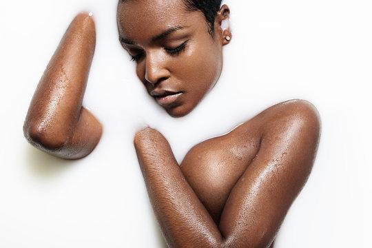 black woman have a milk bath