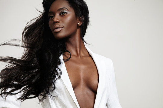 beauty black woman with a stright blowing hair