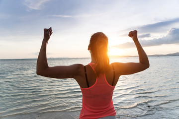 Motivated woman enjoying freedom and exercising success