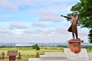 Professor William Smith Clark statue and city landscape background in Sapporo, Hokkaido - Japan.