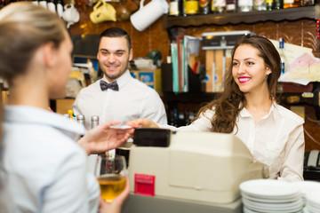 Girl at counter in bar